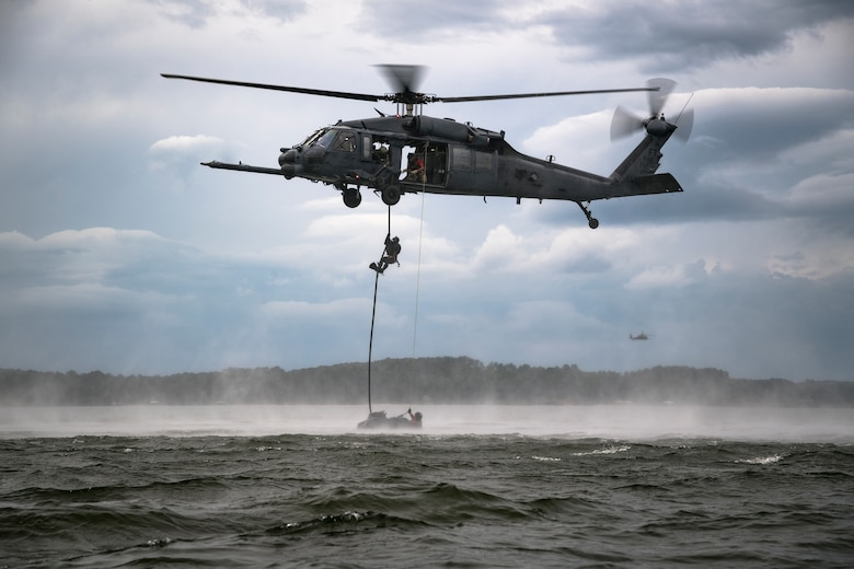 A pararescueman fast-ropes from an HH-60G Pave Hawk
