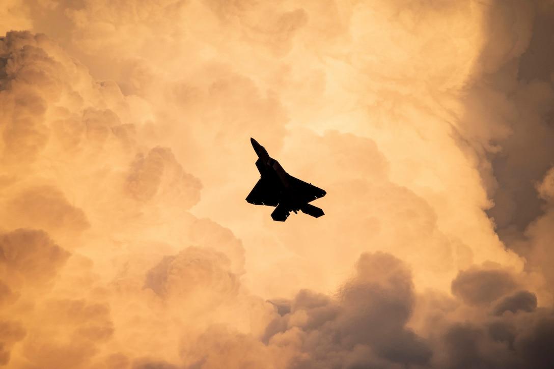 F-22 Raptor Demonstration Team commander, flies a twilight demonstration