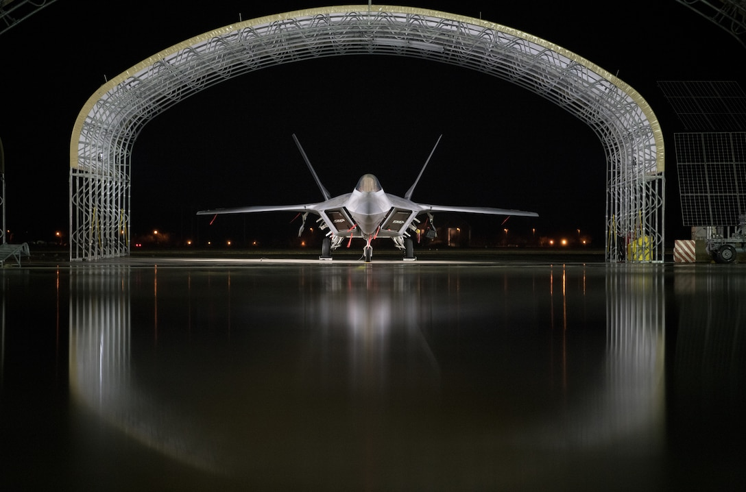 An Air Force F-22 Raptor is parked on the flightline