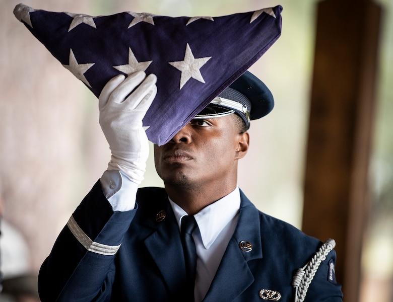 Staff Sgt. inspects a folded American fla