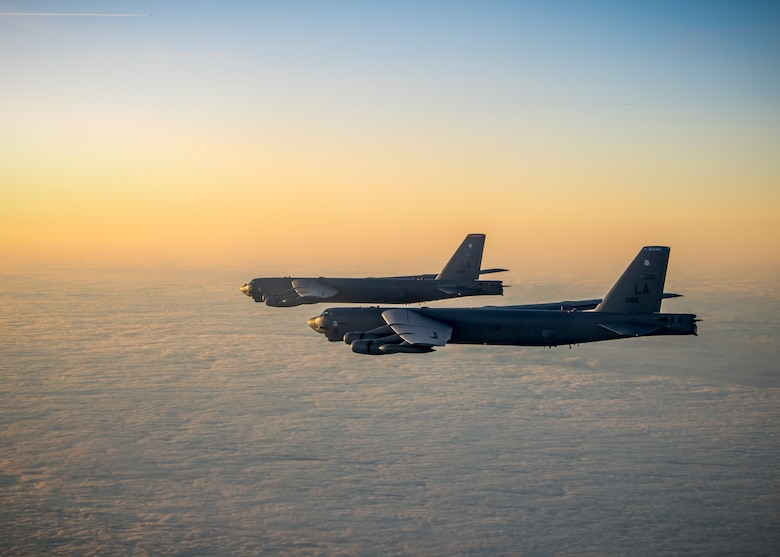 Two B-52H Stratofortress aircraft assigned to the 96th Bomb Squadron fly in formation