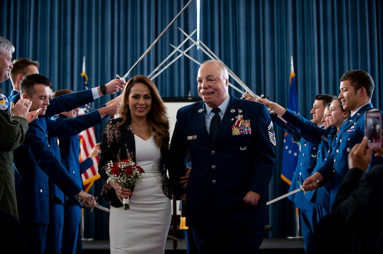 Senior Master Sgt. Israel Del Toro and his wife, Carmen, renew their wedding vows during his retirement ceremony