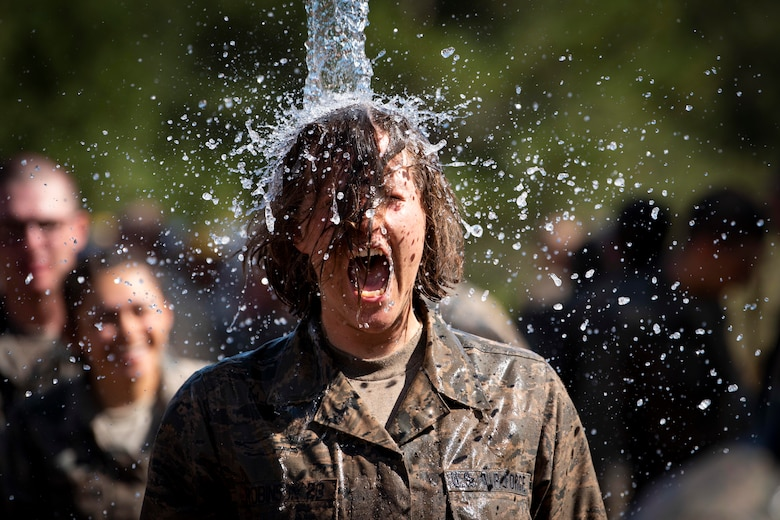 Cadets from the class of 2023 immerse themselves in water after completing the Assault Course