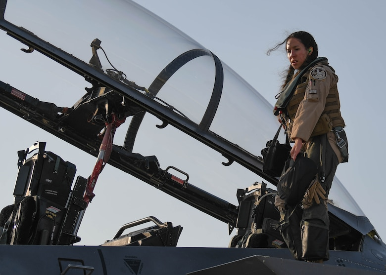 Weapons system officer, exits an Air Force F-15E Strike Eagle