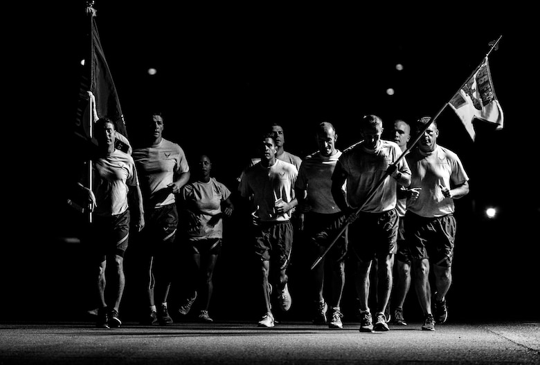 Airmen honor former prisoners of war and those listed as missing in action during a 24-hour vigil run