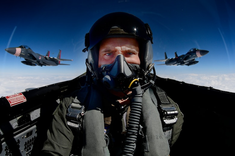 Photojournalist takes a selfie while documenting two F-15E Strike Eagles and an F-15C Eagle