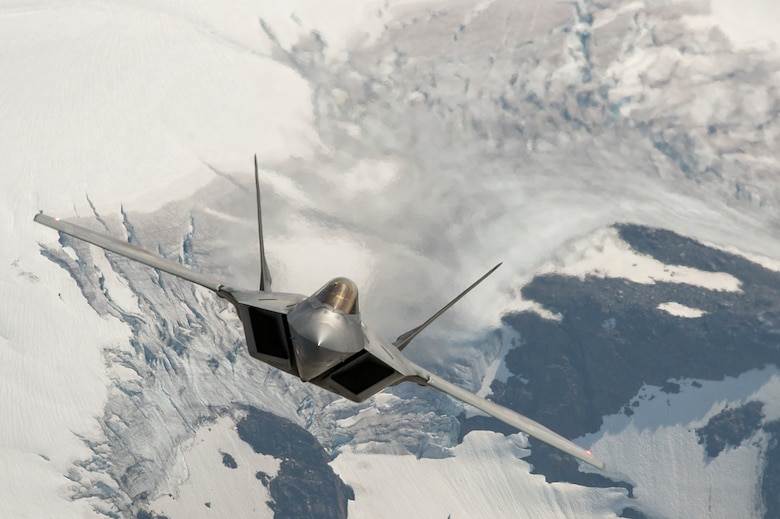 An F-22 Raptor flies in formation over the Joint Pacific Alaska Range Complex