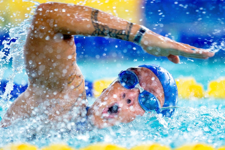 Retired Staff Sgt. Kristina Coble swims freestyle during the 2019 Department of Defense Warrior Games
