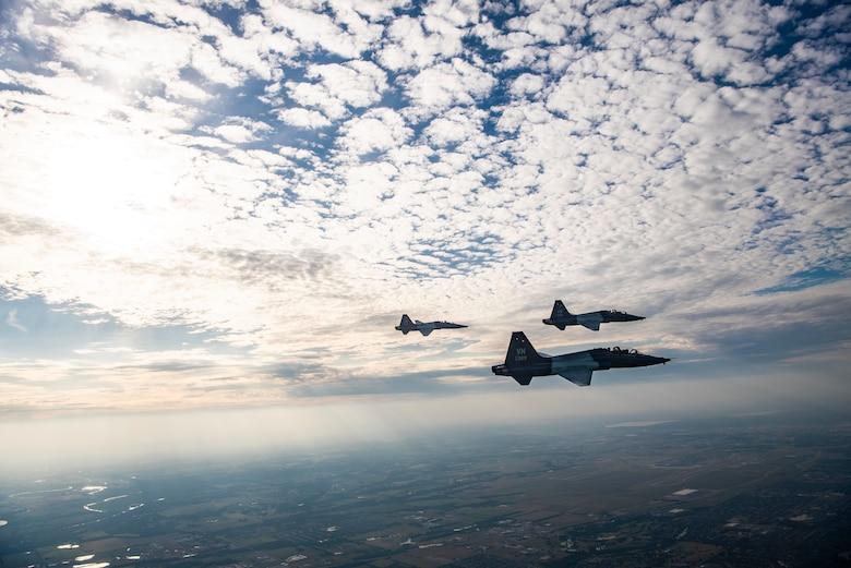 Pilots soar through the sky in a T-38C Talon