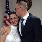 Sgt. James Green, assigned to the 1st Armored Division Mobile Command Post Operational Detachment, Texas Army National Guard, kisses his wife, Hannah, on their wedding day, May 12, 2017.