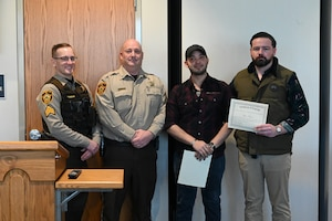 Photo of Tech Sgt. Ryan Fontaine being recognized by Ward County, N.D. Sheriff.