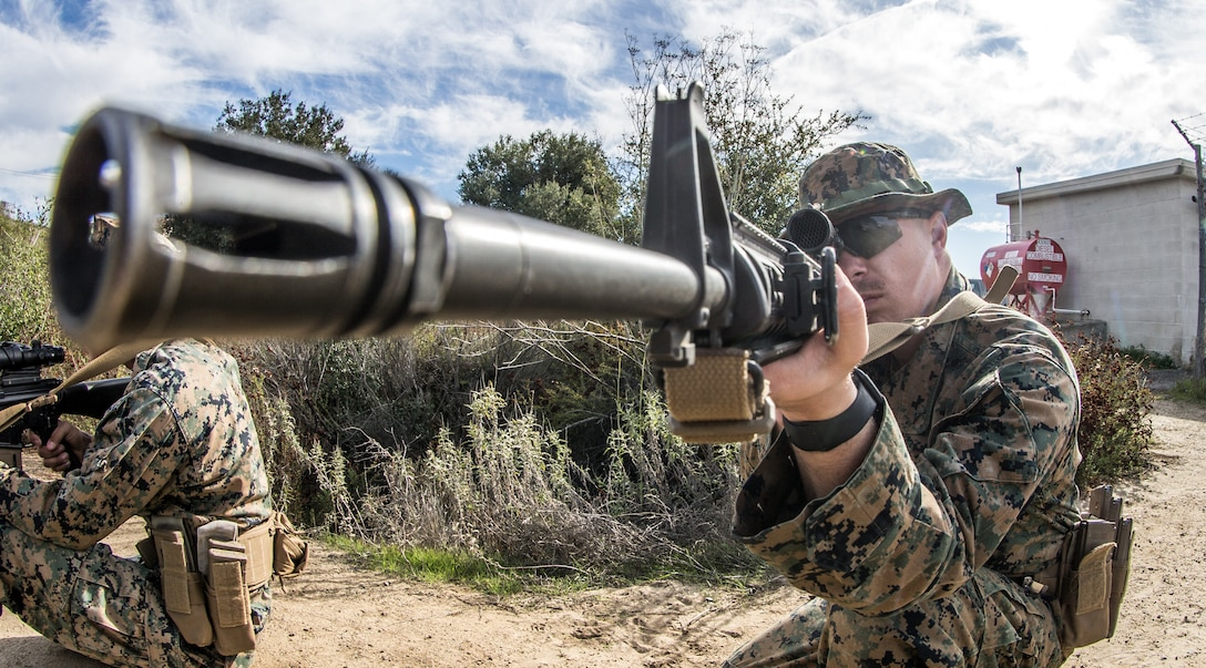 A U.S. Marine sights in on a barrel at the 1st Maint. Bn. Marksmanship Trainer Unit on Marine Corps Base Camp Pendleton, California, Jan. 7.