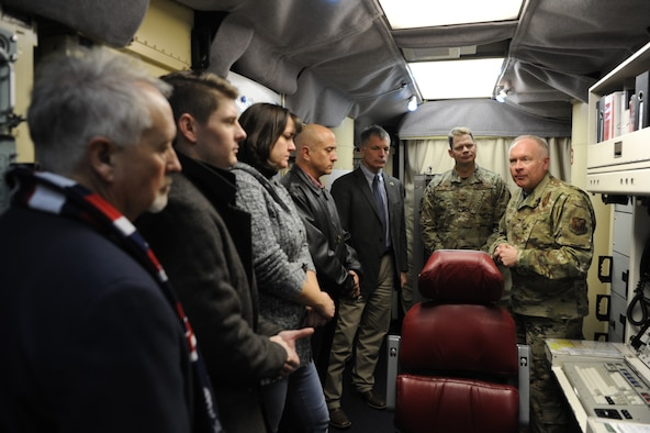 Major General Fred Stoss, 20th Air Force Commander, explains the responsibilties of a missileer to Wyoming governor Mark Gordon and some of his staff members while in a launch control capsule during a visit Dec. 20 to F. E .Warren Air Force Base, Wyo. The governor visited a missile alert facility, a launch facility and facilities on base to speak to Airmen and gain a better understanding of the wing's mission. (U. S. Air Force photo by Glenn S. Robertson)
