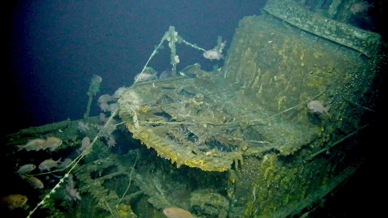 The hull of a ship that has been underwater for decades shows algae  and decay.