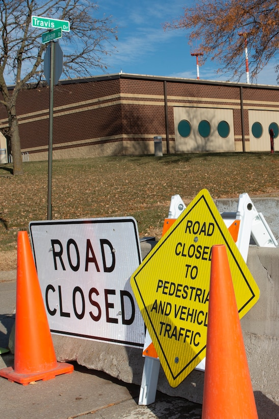 Construction signs sit on a closed road at Offutt Air Force Base, Neb., Nov. 19, 2019.