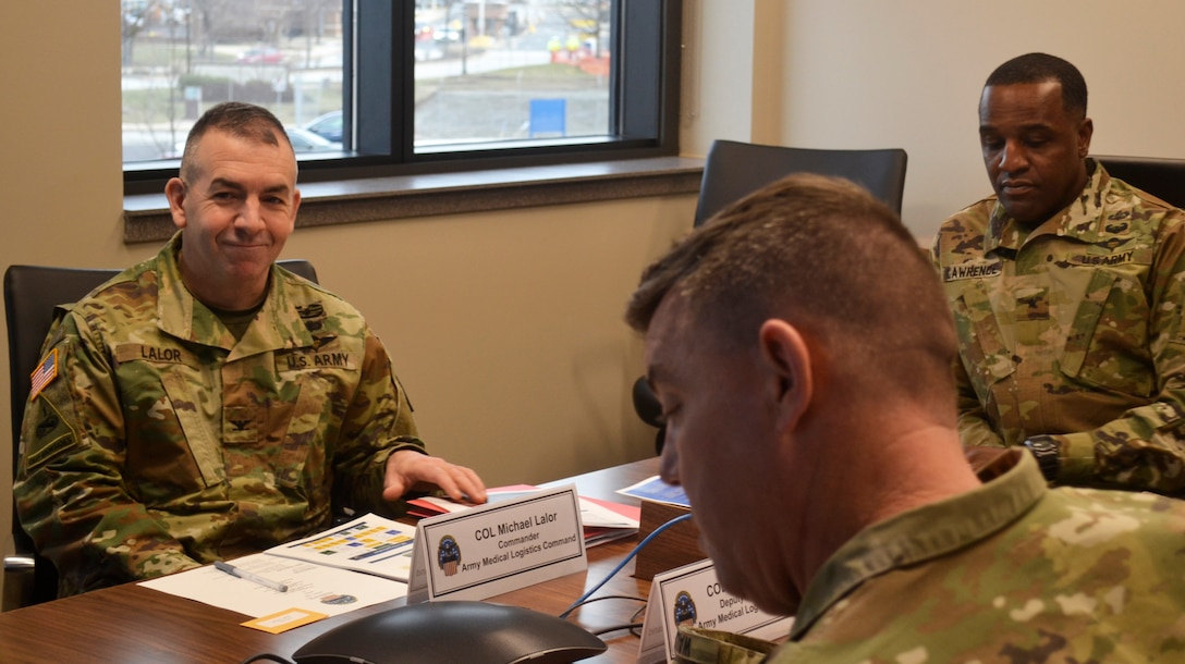 Army Col. Michael Lalor, Army Medical Logistics Command commander, left, sits in on a briefing at DLA Troop Support Jan. 7, 2020 in Philadelphia.