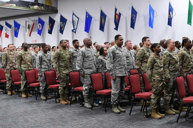 Photo of Airmen standing at attention.