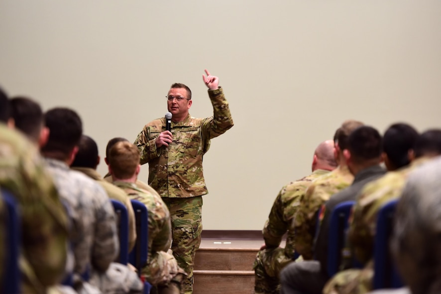 Chief Master Sergeant David Wade, Command Chief of Air Combat Command, speaks with Airmen in an all-call at Creech Air Force Base.