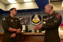 A lieutenant speaks with General Mike Holmes, commander of Air Combat Command, during a visit.