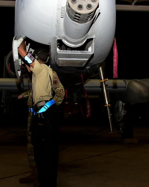 Airman inspects an A-10