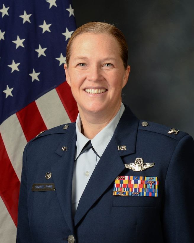 Col. Erin Staine-Pyne official photo with American flag background