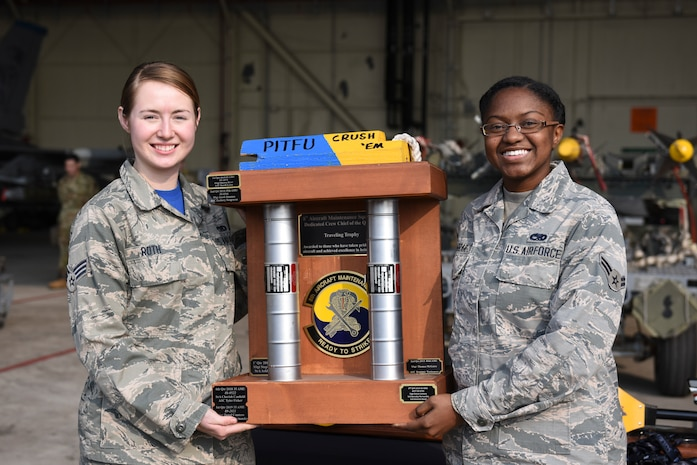 Representing the 35th Aircraft Maintenance Unit, U.S. Air Force Senior Airman Tamara Roth and Airman 1st Class Courtney Farrer, won dedicated crew chief team of the quarter during the 8th Maintenance Group's fourth quarter Weapons Load Crew Competition at Kunsan Air Base, Republic of Korea, Jan. 3, 2020. The teams were evaluated on aircraft appearance, personal dress and appearance, and overall maintenance knowledge. (U.S. Air Force photo by Staff Sgt. Mackenzie Mendez)