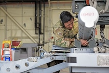 U.S. Air Force Staff Sgt. David Torres, 35th Aircraft Maintenance Unit load crew team chief, loads an F-16 Fighting Falcon aircraft during the 8th Maintenance Group's fourth quarter Weapons Load Crew Competition at Kunsan Air Base, Republic of Korea, Jan. 3, 2020. The three-person crews were evaluated on safety, reliability, technical proficiency and time. (U.S. Air Force photo by Staff Sgt. Mackenzie Mendez)