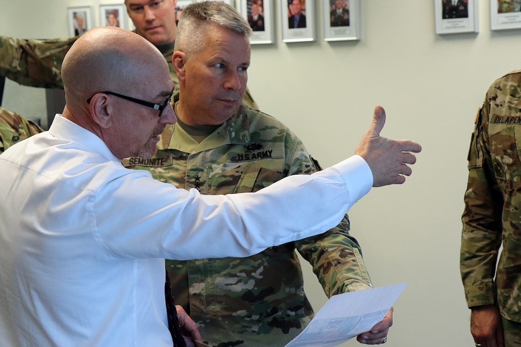 Transatlantic Division Logistics Director Todd Hasbrouck (left) shows off the changes being made to the TAD Headquarters in Winchester, Va., to Lt. Gen. Todd T. Semonite, the 54th Chief of Engineers and Commanding General of the U.S. Army Corps of Engineers.  Semonite and USACE Command Sergeant Major Bradley Houston drove 70 miles through the winter mix that enveloped Northern Virginia to visit with the men and women of the Transatlantic Division in Winchester, Va., Jan. 7, 2020.