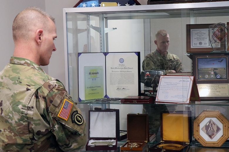 USACE Command Sergeant Major Bradley Houston admires one of the display cases at the Transatlantic Division headquarters in Winchester, Va.