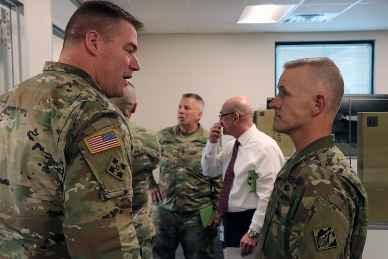 """Transatlantic Division Commander Col. Chris Beck (left) discusses the work being done to the TAD headquarters building as part of the TAD """"workforce transformation"""" plan with USACE Command Sergeant Major Bradley Houston."""