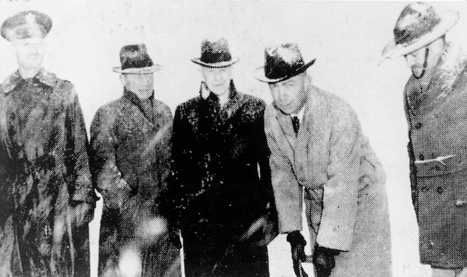 A black and white photo of five men posing for a photo during the ground breaking of Hill Field on Jan. 12, 1940.