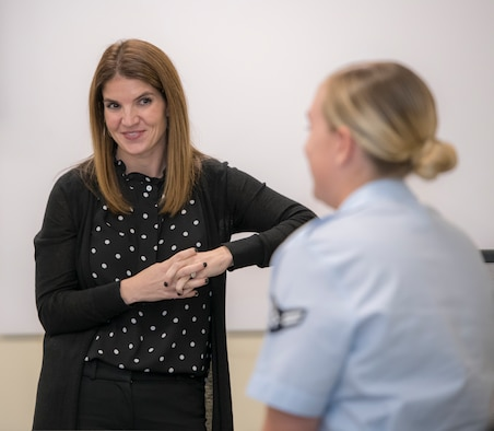 Dr. Julie Landry listens to an Airman during a new student briefing at the 558th Flying Training Squadron at JBSA-Randolph. As the unit psychologist, she teaches students and staff resiliency. (U.S. Air Force photo by Sabrina Fine)