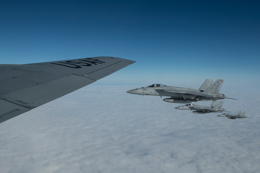 U.S. Navy F/A-18E Super Hornets fly alongside a 909th Air Refueling Squadron KC-135 Stratotanker after aerial refueling during Exercise WestPac Rumrunner at Kadena Air Base, Japan, Jan. 10, 2020. The exercise provides an opportunity for Kadena Airmen to practice a diverse array of capabilities in addition to working alongside joint partners in the Army, Navy and Marine Corps. (U.S. Air Force photo by Tech. Sgt. Matthew B. Fredericks)