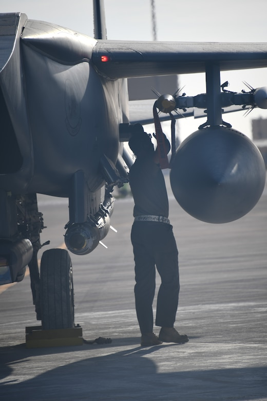 U.S. Air Force Staff Sgt. Zackary Suttles, a crew chief with the 378th Expeditionary Maintenance Squadron, conducts a post landing inspection on an F-15E Strike Eagle at Prince Sultan Air Base, Kingdom of Saudi Arabia, Jan. 4, 2020.
