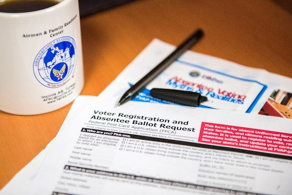 A voter registration and absentee ballot lies on a table in the Airman and Family Readiness Center, Jan. 8, 2020, at Incirlik Air Base, Turkey. Though Incirlik Airmen may be away from their home state, they still have the ability to submit an absentee ballot. (U.S. Air Force photo by Senior Airman Trevor Gordnier)