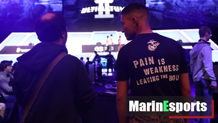 A U.S. Marine recruiter with Recruiting Station Dallas converses with an attendee during Ultimatum II, a Smash Ultimate Tournament hosted by Esports Stadium Arlington, in Arlington, Texas, December 27, 2019.
