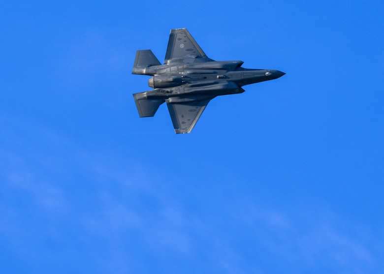 F-35s and F-16s soar in the morning sky