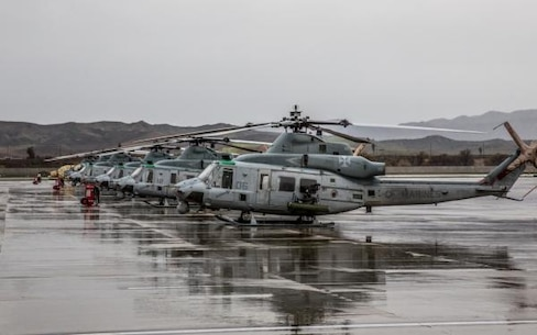UH-1Y Venom helicopters sit in the rain