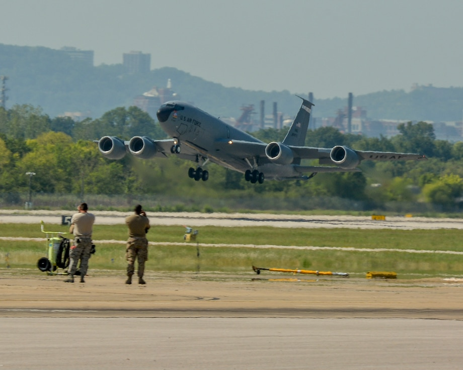 Maintenance personnel from the 117th Air Refueling Wing watch as a KC-135R Stratotanker takes off.
