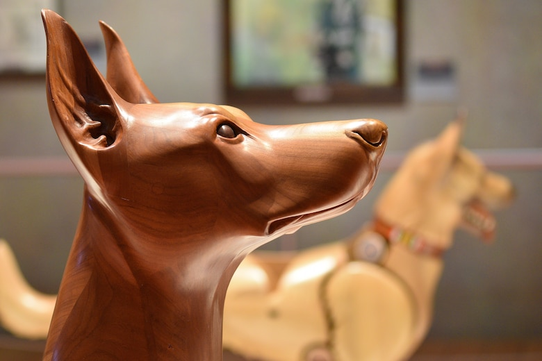 Photo of a wooden dog carving.