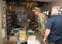 Ed Stewart, NSWC PCD technical director and Capt. Aaron Peters, commander, NSWC PCD, give Rear Adm. Eric Ver Hage, commander, Naval Surface and Undersea Warfare Centers, a tour of hurricane damaged buildings during Ver Hage's visit to NSWC PCD April 30, 2019.