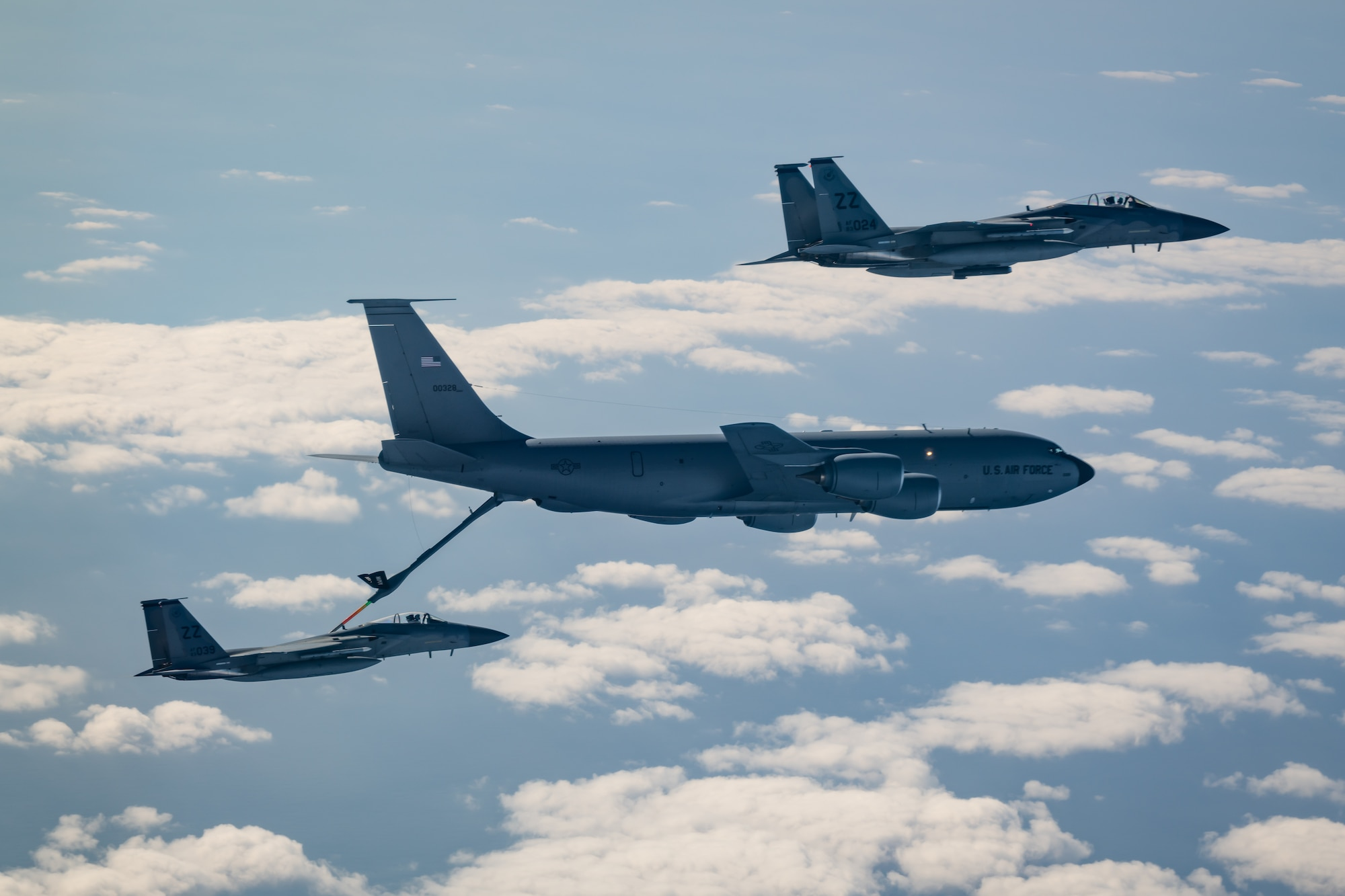 Two F-15C Eagles from the 44th Fighter Squadron refuel with a KC-135 Stratotanker from the 909th Air Refueling Squadron Jan. 10, 2020, during Exercise WestPac Rumrunner out of Kadena Air Base, Japan. Rumrunner represents an evolution in the capabilities of 18th Wing assets to work with joint partners to defend American allies and ensures a free and open Indo-Pacific. (U.S. Air Force photo by Senior Airman Matthew Seefeldt)