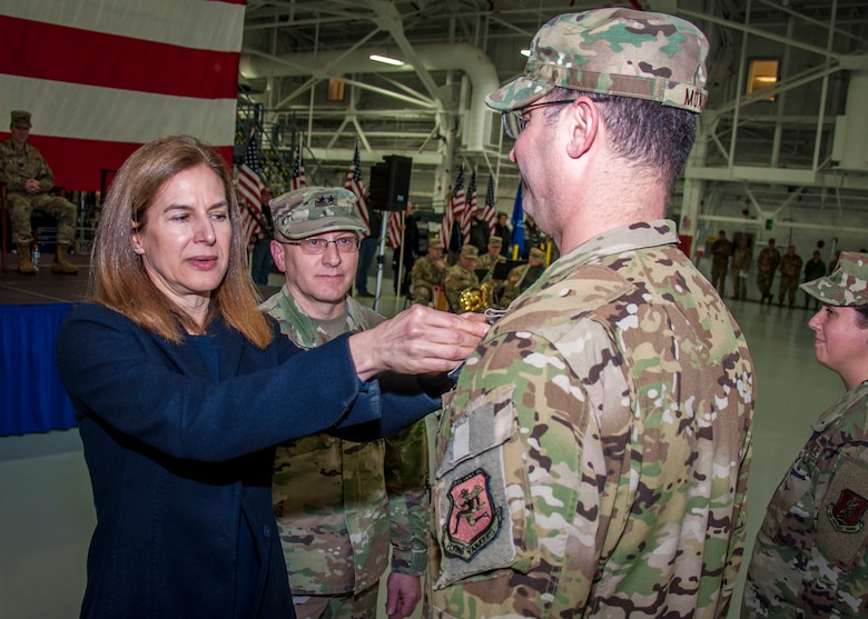 Connecticut Lt. Gov. Susan Bysiewicz presents the Air Force Meritorious Service Medal to Maj. David Monico, during a Freedom Salute Ceremony at Bradley Air National Guard Base, East Granby, Conn. Jan. 4, 2020. Monico served as the director of operations for the 779th Expeditionary Airlift Squadron and led the daily operations of two Air National Guard squadrons which were melded into one max-efficient Air and Space Expeditionary Force. (Photo by Tim Koster, Connecticut National Guard Joint Force Headquarters Public Affairs)