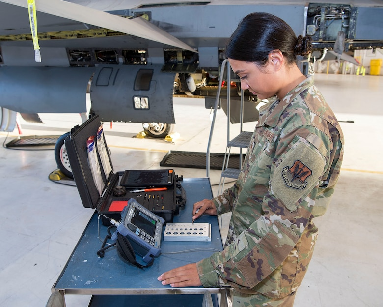 Female Airman conducting test on F-16