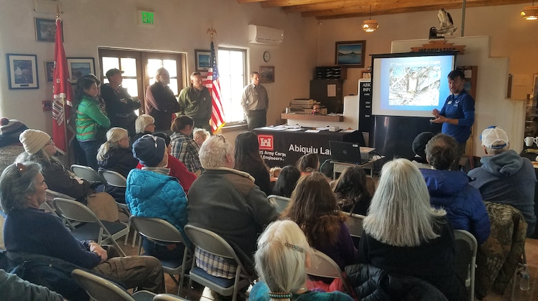 Alex Patia, with the New Mexico Wildlife Center, gives a short presentation to volunteers during the annual eagle watch at Abiquiu Lake, Jan. 4, 2020. Patia discussed the history of the survey, how to identify immature and mature eagles, and what other birds may be out on the lake at this time of year.