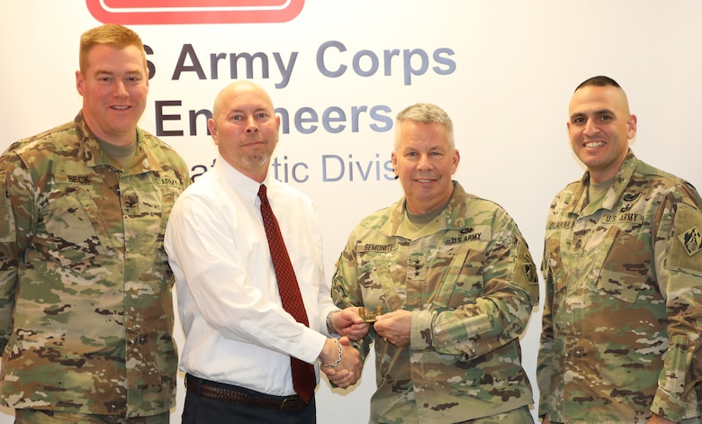 """Lt. Gen. Todd T. Semonite, the 54th Chief of Engineers and Commanding General of the U.S. Army Corps of Engineer, """"coined"""" TAD Logistics Specialist Tim O'Dell."""