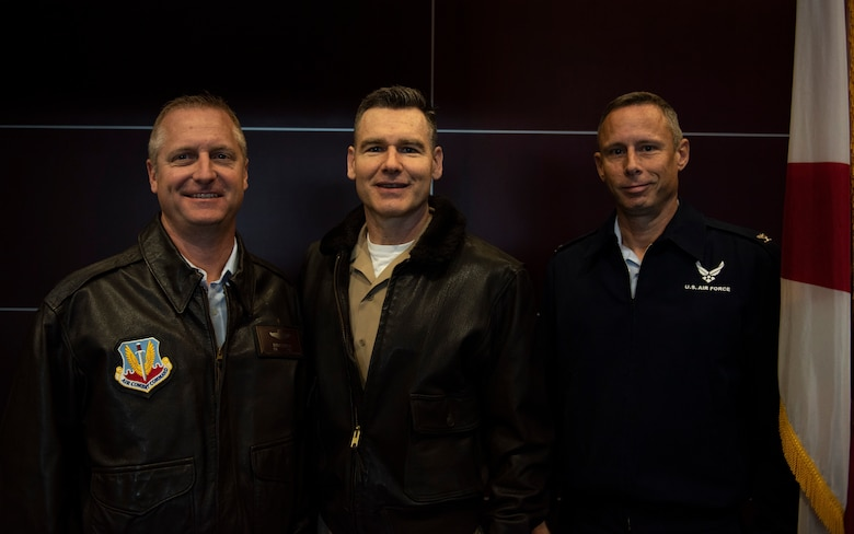 U.S. Air Force Col. Brian Laidlaw, 325th Fighter Wing commander, left, U.S. Navy Cmdr. Kevin Christenson, Naval Support Activity Panama City commanding officer, center, and U.S. Air Force Col. Travis Leighton, Tyndall Program Management Office director, pose for a photo at the Bay County Chamber of Commerce First Friday meeting at Panama City, Florida, Jan. 10, 2020. They attended the event as representatives of military communities in the local area. (U.S. Air Force photo by Staff Sgt. Magen M. Reeves)