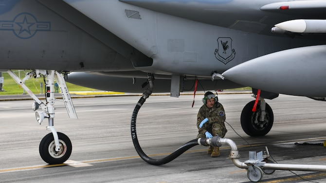 A maintainer from the 18th Aircraft Maintenance Squadron prepares to fuel an F-15 Eagle during Exercise Rumrunner at Marine Corps Air Station Futenma, Japan, Jan. 10, 2020. Airmen from the 18th Wing operate in a safe and e3nvironmentally conscious manner and adhere to strict standards set by Department of Defense and host-governments at all times. (U.S. Air Force photo by Staff Sgt. Benjamin Raughton)