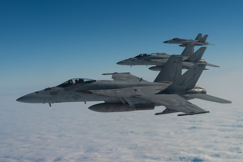 Three U.S. Navy F/A-18E Super Hornets from Marine Corps Air Station Iwakuni, Japan, fly in formation during Exercise WestPac Rumrunner Jan. 10, 2020. The WestPac Rumrunner exercise brought Airmen and joint partners together to train and execute innovative ways to deploy forces in a contested environment. (U.S. Air Force photo by Senior Airman Cynthia Belío)