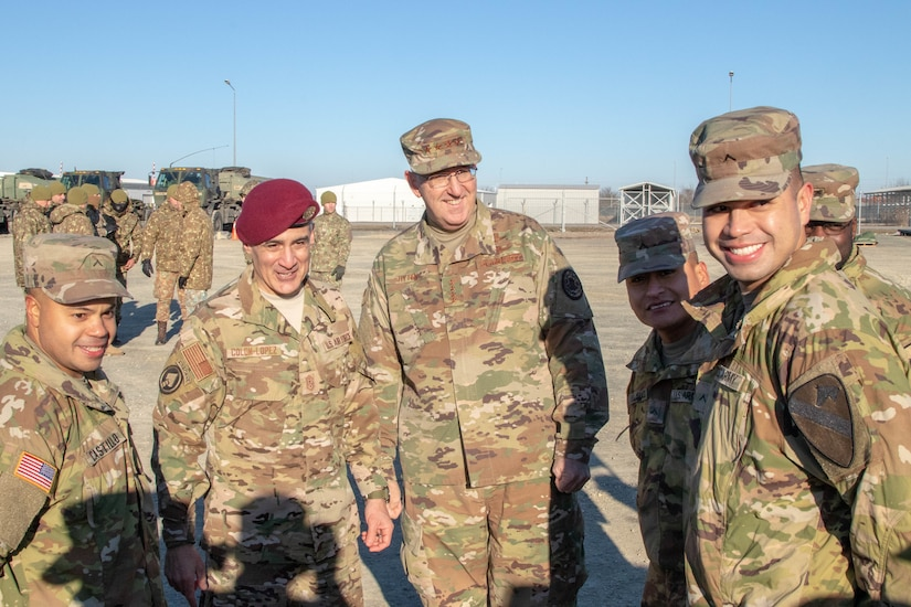 Defense leaders speak with troops.